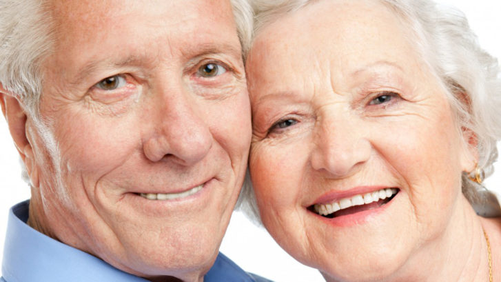 Couple wearing dentures